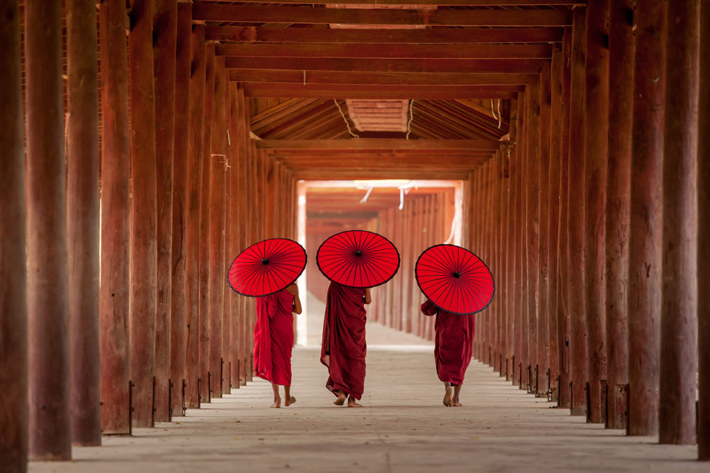 EARS - Buddhists with umbrellas