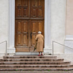 EARS - Woman at church door